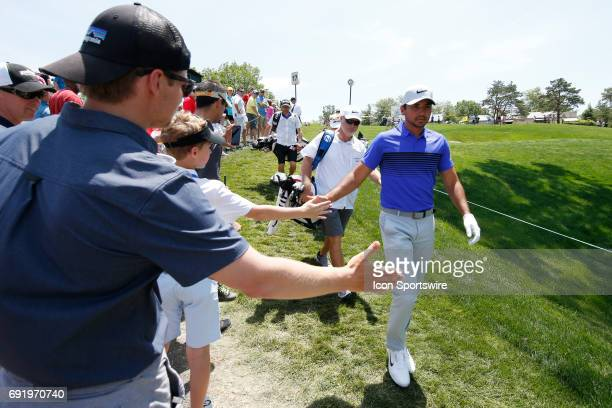 PGA golfer Jason Day high fives fans as he walks to the 18th tee during the Memorial Tournament Third Round on June 03 2017 at Muirfield Village Golf...
