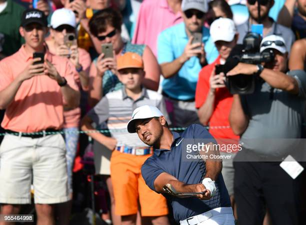 Golfer Jason Day is the center of the gallery's attention as he chips onto the 18th green during the fourth round of the Wells Fargo Championship on...