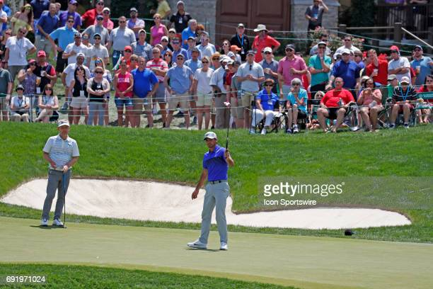 PGA golfer Jason Day reacts to making a birdie putt on the 18th hole during the Memorial Tournament Third Round on June 03 2017 at Muirfield Village...