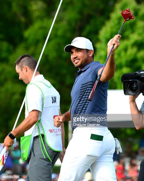 Golfer Jason Day turns to the gallery and smiles after winning the Wells Fargo Championship on Sunday, May 6, 2018 at Quail Hollow Club in Charlotte,...