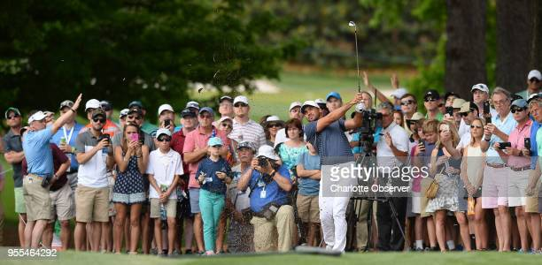 Golfer Jason Day watches the flight of his drive with the gallery after hitting from the rough along the seventh fairway during fourth round action...