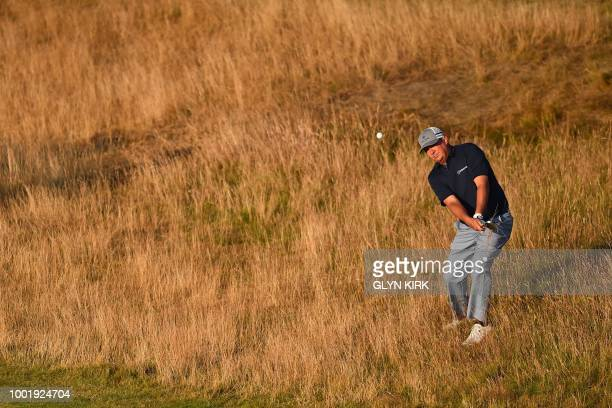 Golfer Jason Dufner plays out of the rough on the 17th hole during his first round on day one of The 147th Open golf Championship at Carnoustie,...