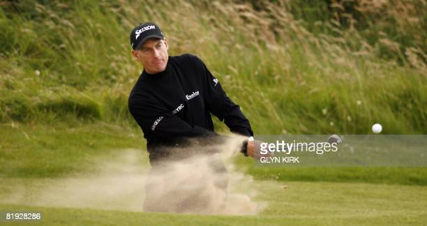 Golfer Jim Furyk plays from a bunker during a practice round on July 14 for the forthcoming Open Championship to be held on July 17-20, on the Royal...