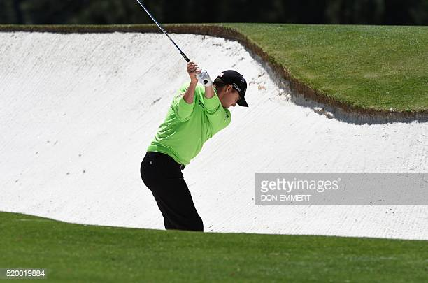 US golfer Jimmy Walker hits out of a bunker during Round 3 of the 80th Masters Golf Tournament at the Augusta National Golf Club on April 9 in...