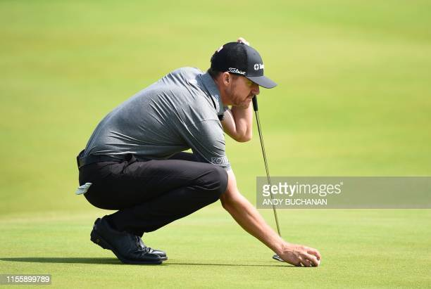US golfer Jimmy Walker lines up a putt during a practice session at The 148th Open golf Championship at Royal Portrush golf club in Northern Ireland...