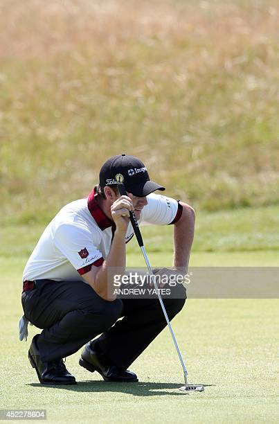 US golfer Jimmy Walker lines up his putt on the 13th green during his first round 69 on the opening day of the 2014 British Open Golf Championship at...