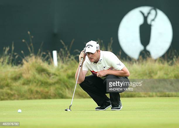 US golfer Jimmy Walker lines up his putt on the 3rd green during his third round on day three of the 2014 British Open Golf Championship at Royal...