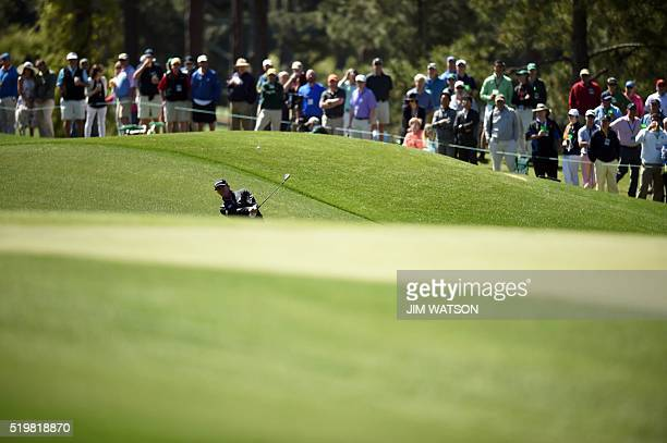 US golfer Jimmy Walker plays a shot during Round 2 of the 80th Masters Golf Tournament at the Augusta National Golf Club on April 8 in Augusta...