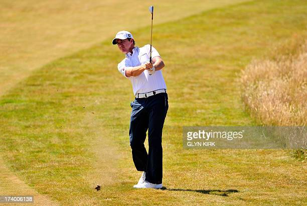 US golfer Jimmy Walker plays a shot from the second fairway during the second round of the 2013 British Open Golf Championship at Muirfield golf...