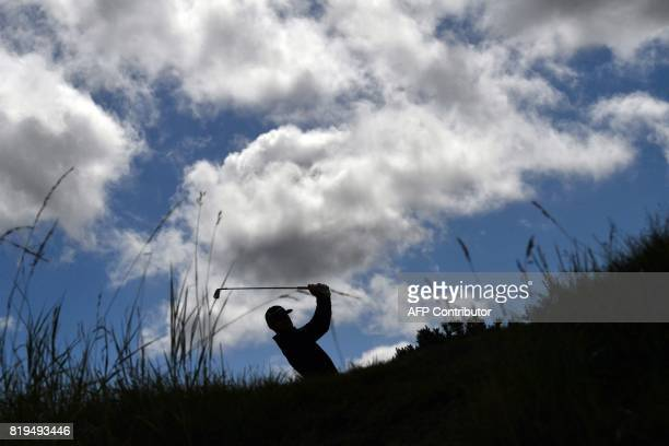 TOPSHOT US golfer Jimmy Walker plays from the 4th tee during his opening round on the first day of the Open Golf Championship at Royal Birkdale golf...