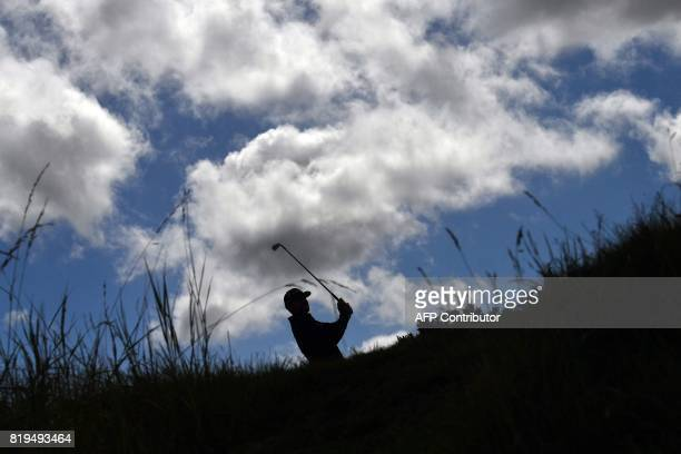 US golfer Jimmy Walker plays from the 4th tee during his opening round on the first day of the Open Golf Championship at Royal Birkdale golf course...
