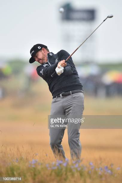 US golfer Jimmy Walker plays from the rough on the 6th hole during his second round on day 2 of The 147th Open golf Championship at Carnoustie...