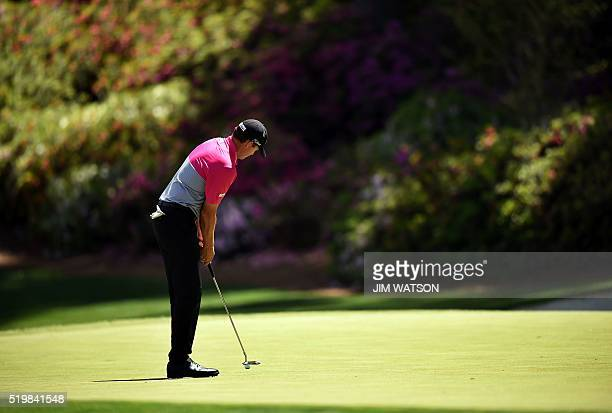 US golfer Jimmy Walker putts on the 14th hole during Round 2 of the 80th Masters Golf Tournament at the Augusta National Golf Club on April 8 in...