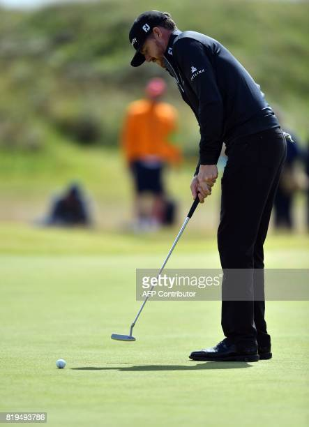 US golfer Jimmy Walker putts on the 4th green during his opening round on the first day of the Open Golf Championship at Royal Birkdale golf course...