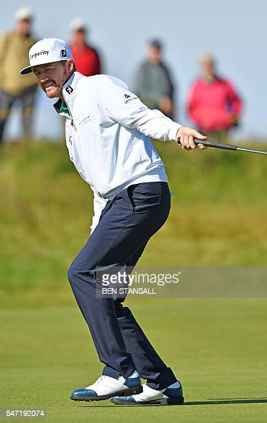 US golfer Jimmy Walker reacts to his putt on the 4th Green during his first round on the opening day of the 2016 British Open Golf Championship at...