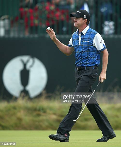 US golfer Jimmy Walker reacts to making birdie on the 3rd green during his third round on day three of the 2014 British Open Golf Championship at...