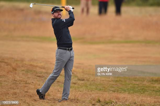 US golfer Jimmy Walker watches his approach shot on the 3rd fairway during his second round on day 2 of The 147th Open golf Championship at...