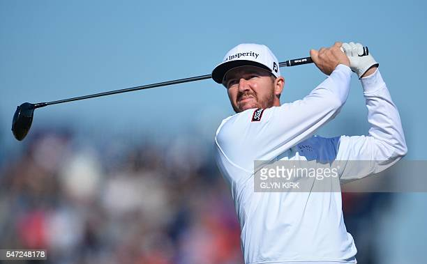 US golfer Jimmy Walker watches his drive from the 6th tee during his first round on the opening day of the 2016 British Open Golf Championship at...