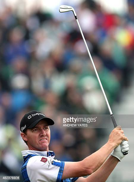 US golfer Jimmy Walker watches his shot from the 4th tee during his third round on day three of the 2014 British Open Golf Championship at Royal...
