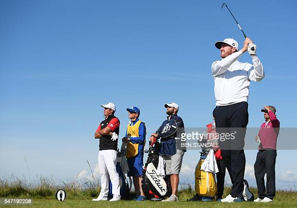 US golfer Jimmy Walker watches his shot from the 5th tee during his first round on the opening day of the 2016 British Open Golf Championship at...