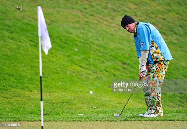 US golfer John Daly chips onto the 3rd green during the second round of the BMW PGA Championship at Wentworth Golf Club in Surrey England on May 27...