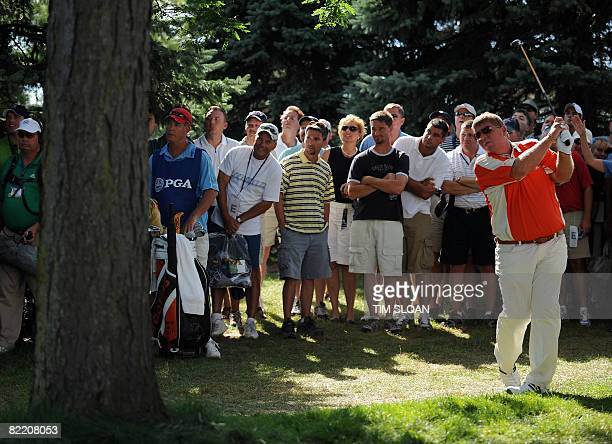 US golfer John Daly hits from the gallery along the 12th fariway during the opening round of the 90th PGA Championship at Oakland Hills Country Club...