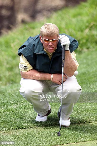 US golfer John Daly lines up his ball during the first round of the US Open 15 June 2000 at Pebble Beach California Daly withdrew from the tournament...