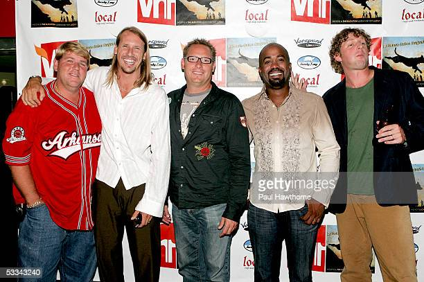 Golfer John Daly poses with Hootie and the Blowfish band members Jim Soni Sonefeld Dean Felber Darius Rucker and Mark Bryan as they attend a...