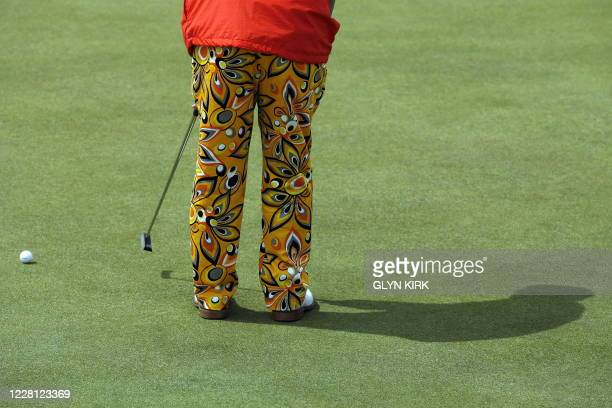US golfer John Daly putts on the 2nd green on the third day of the 138th British Open Championship at Turnberry Golf Course in south west Scotland on...