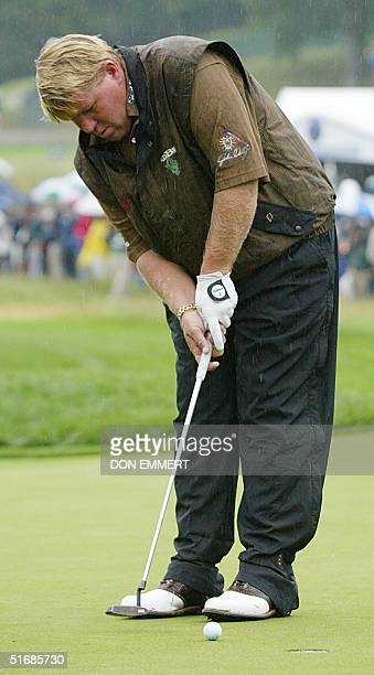 US golfer John Daly taps in for boogie on the 1st green during the second round at the 102nd US Open Championship 14 June 2002 at Bethpage State Park...