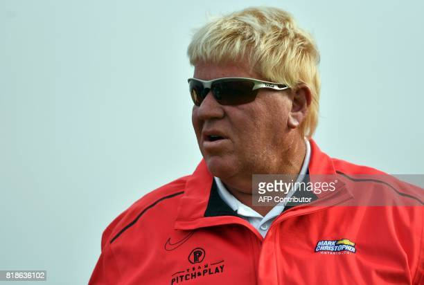 US golfer John Daly waits on the 9th tee during a practice round at Royal Birkdale golf course near Southport in north west England on July 19 ahead...