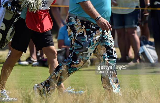 US golfer John Daly wearing his unusual colourful trousers leave the 1st tee during his first round on the opening day of the 2014 British Open Golf...