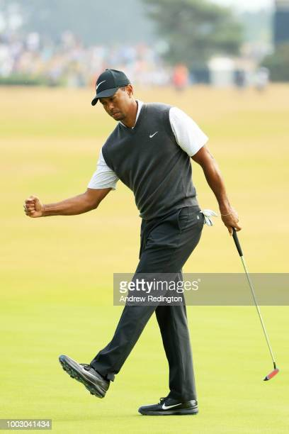 US golfer Jordan Spieth acknowledges the applause after holing his putt on the 17th green during his third round on day 3 of The 147th Open golf...