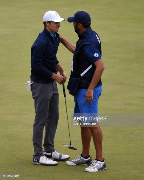 US golfer Jordan Spieth and his caddie Michael Greller celebrate on the 18th green after Spieth's final round 69 to win the Championship on day four...