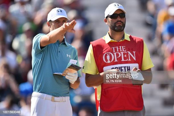 US golfer Jordan Spieth and his caddie Michael Greller consult their notes on the 3rd tee during his first round on day one of The 147th Open golf...