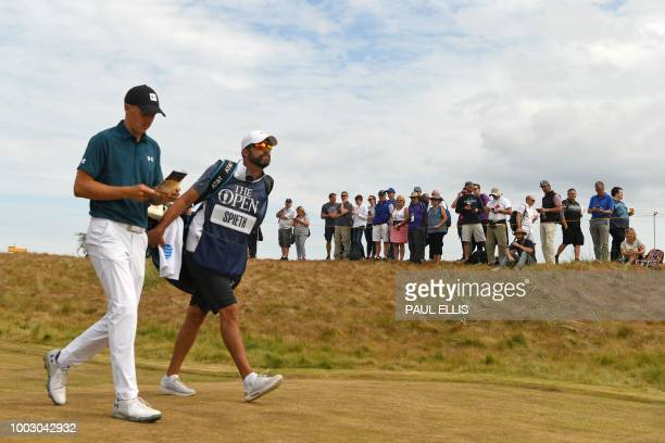 US golfer Jordan Spieth and his caddie Michael Greller walk up the 4th fairway during his third round on day 3 of The 147th Open golf Championship at...