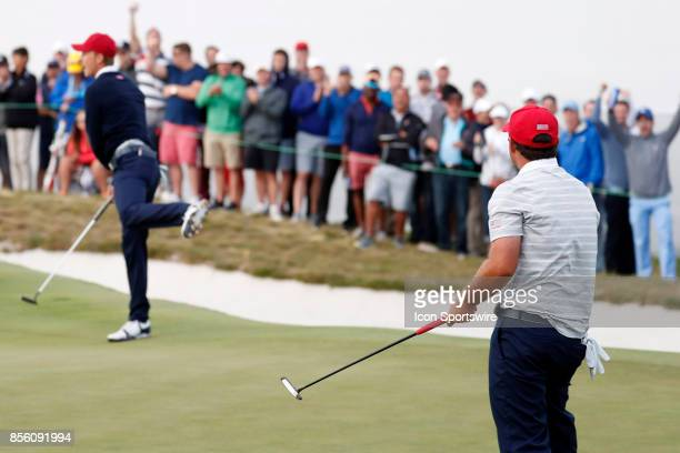 USA golfer Jordan Spieth and Patrick Reed react after Reed makes a putt on the 16th hole during the third round of the Presidents Cup at Liberty...