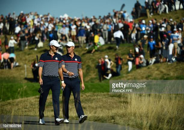 US golfer Jordan Spieth and US golfer Justin Thomas speak during a practice session ahead of the 42nd Ryder Cup at Le Golf National Course at...