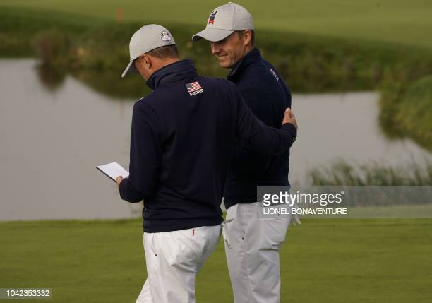 Golfer Jordan Spieth and US golfer Justin Thomas speak during their fourball match on the first day of the 42nd Ryder Cup at Le Golf National Course...