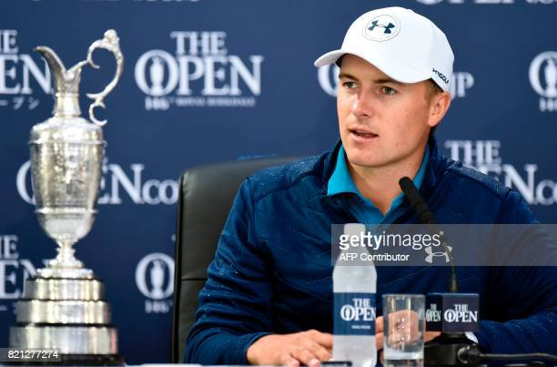 US golfer Jordan Spieth answers questions from members of the media as he sits with the Claret Jug the trophy for the Champion golfer of the year at...