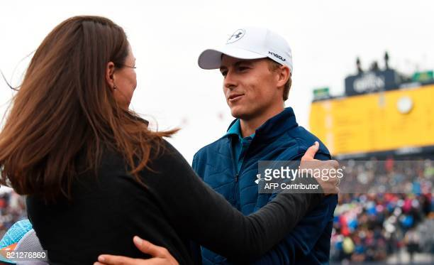 US golfer Jordan Spieth embraces his girlfriend Annie Verret at the back of the 18th green after his final round 69 to win the Championship on day...