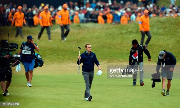 US golfer Jordan Spieth gestures to the spectators as he walks down the 18th fairway during his final round on day four of the 2017 Open Golf...