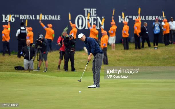 US golfer Jordan Spieth holes his final putt on the 18th green to win the Championship on day four of the 2017 Open Golf Championship at Royal...