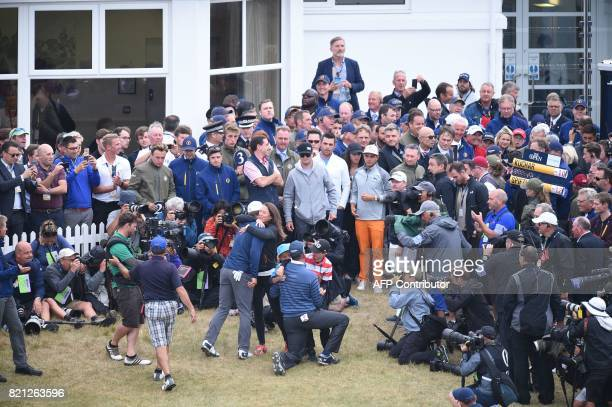 US golfer Jordan Spieth hugs his girlfriend Annie Verret at the back of the 18th green after his final round 69 to win the Championship on day four...