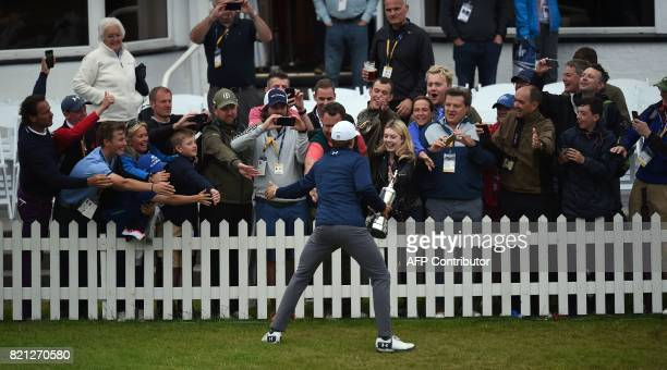 US golfer Jordan Spieth interacts with spectators as he shows off the Claret Jug the trophy for the Champion golfer of the year after winning the...