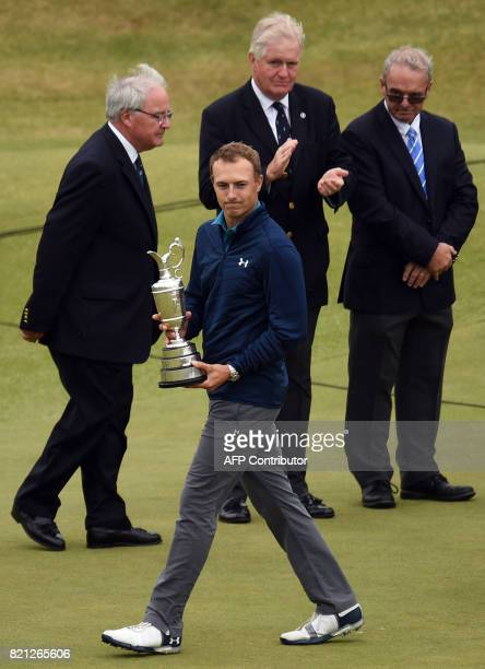 US golfer Jordan Spieth is applauded after being presented with the Claret Jug the trophy for the Champion golfer of the year after winning the 2017...
