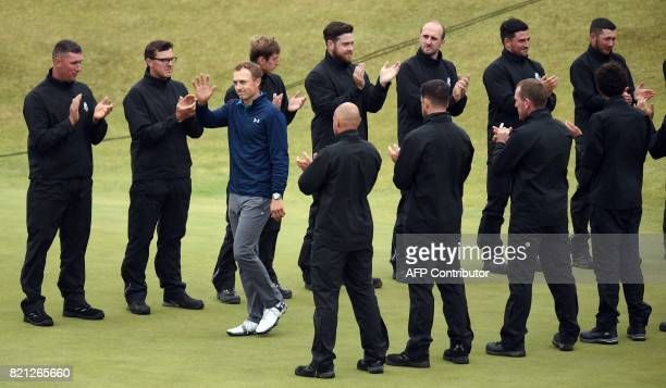 US golfer Jordan Spieth is applauded as he arrives to be presented with the Claret Jug the trophy for the Champion golfer of the year after winning...