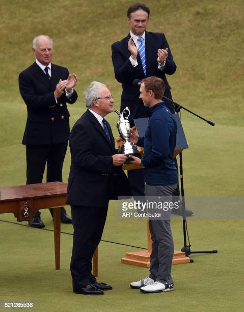 US golfer Jordan Spieth is presented with the Claret Jug the trophy for the Champion golfer of the year after winning the 2017 British Open Golf...