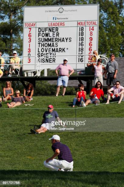 PGA golfer Jordan Spieth lines up a putt on the 17th hole with his name on the leader board in the background during the Memorial Tournament Second...