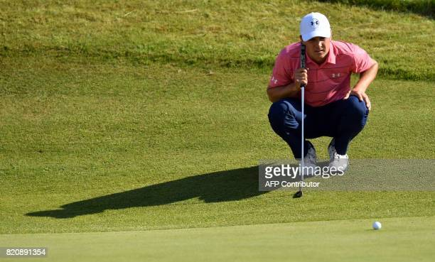 US golfer Jordan Spieth lines up his putt on the 8th green during his third round on day three of the Open Golf Championship at Royal Birkdale golf...